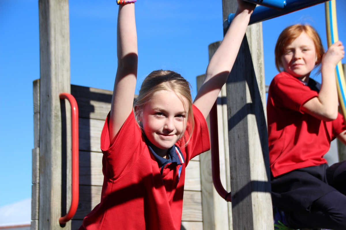 browns bay school students on jungle gym